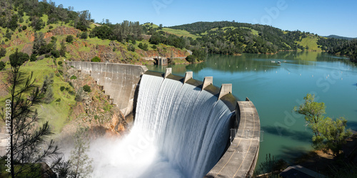 Water spills over the top of Englebright Dam on the Yuba River. A larger than normal snowpack in the Sierra Nevada Mountains has increased runoff into lakes and rivers in California.