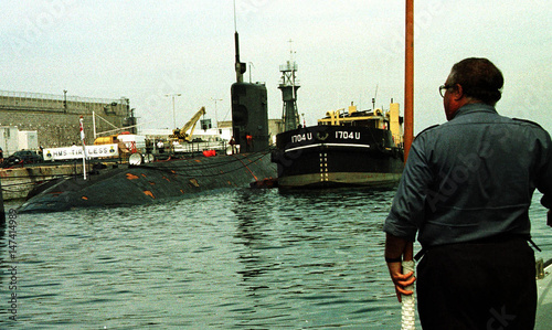 A MAN WATCHES BRITISH HMS TIRELESS NUCLEAR SUBMARINE IN