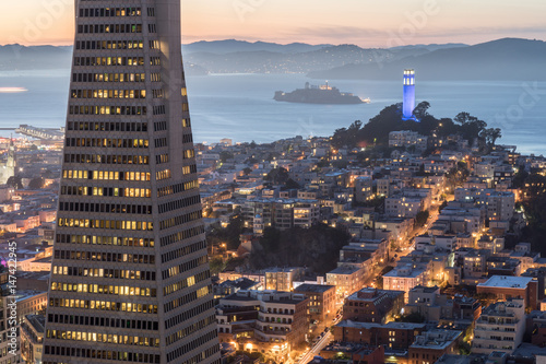 Wall Murals San Francisco Dusk over Telegraph Hill, Alcatraz Island and San Francisco Bay from the Financial District. San Francisco, California, USA.