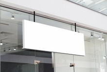 Horizontal White Signage On Shop Front