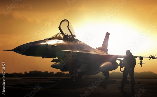 obraz dibond Military jet in silhouette with pilot walking away