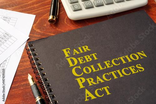 Fotografering  FDCPA Fair Debt Collection Practices Act on a table.