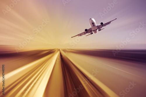 Fotografie, Obraz  Airliner over highway on blurred background