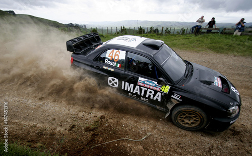Valentino Rossi of Italy negotiates a corner in his Subaru