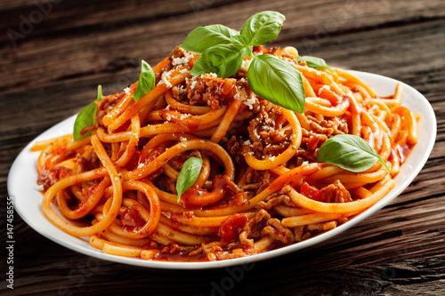 Foto Heaped plate of Italian spaghetti Bolognaise