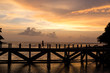 siluate picture women walking on the bridge when sunset time, filling sad or alone