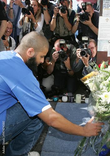 Mohammed Abdul Kahar Places Flowers In Memory Of Brazilian Jean Charles De Menezes At A Shrine