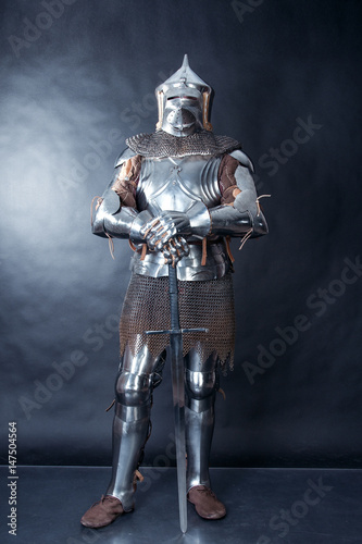 A medieval warrior in a helmet and with a sword Poster Mural XXL