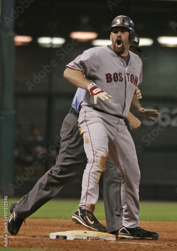 Boston Red Sox batter Kevin Youkilis reacts to being called out at