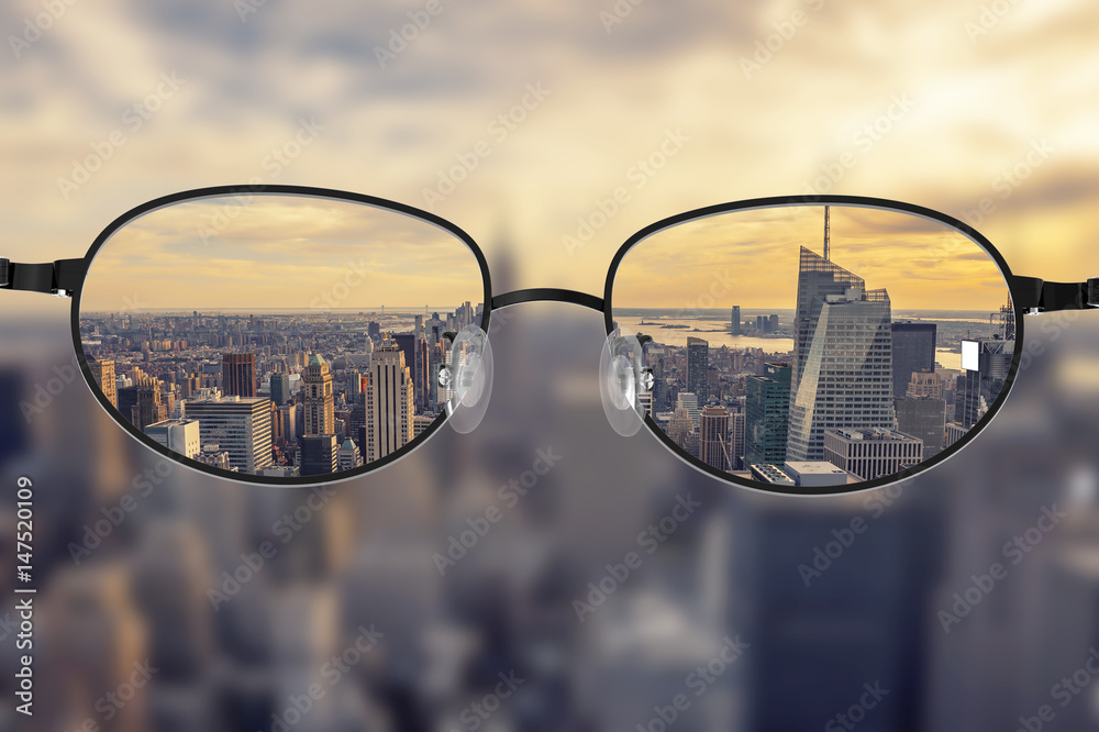 Fototapety, obrazy: Clear cityscape focused in glasses lenses