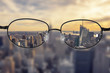 canvas print picture - Clear cityscape focused in glasses lenses