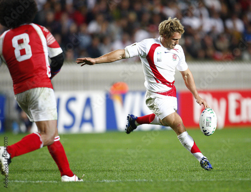 England's Wilkinson scores a drop kick past Tonga's Easter