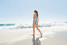 A Girl Walking Along The Beach