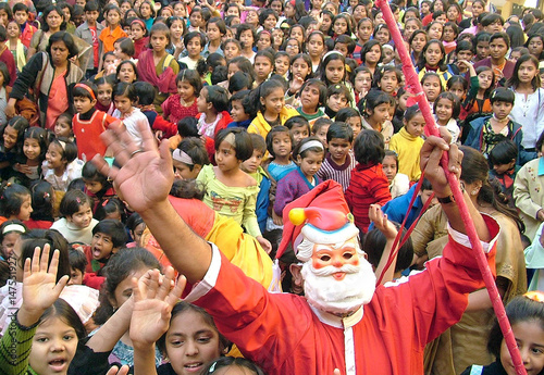 Christmas Festival In India.An Indian Man Donned In Santa Costume Dances To Celebrate