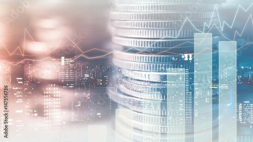 Fotografie, Obraz  Double exposure of city and rows of coins for finance and banking concept
