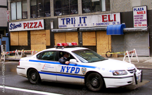 fcdfa4adc4f POLICE CAR PASSES BOARDED UP BUSINESSES NEAR GROUND ZERO. - Buy this ...