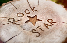 Rock Star. Decorative Inscription Grunge Wood Carving. Beautiful Textured Background