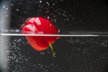Red Bell Pepper Splashing In Water