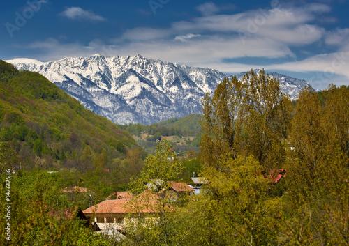 Fototapeta Snowy mountains and village