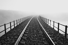 Railway Over A Bridge Disappearing Into The Morning Mist.