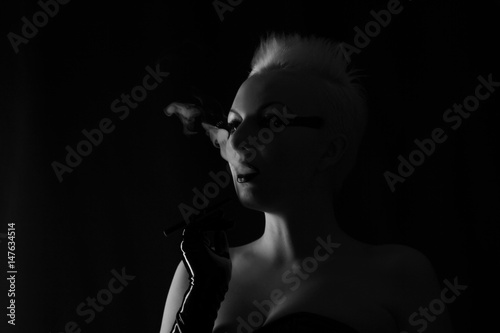 Fototapety, obrazy: pretty alternative woman smoking on black background