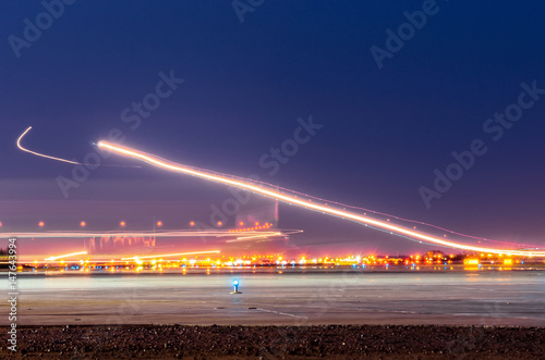 Foto op Aluminium Luchthaven Night lights, tracks of lights in the movement of aircraft on long exposure