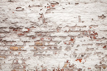 Cracked Brick Wall With Loose Plaster. Red Brickwall Background. Pattern Of Grunge White Parget