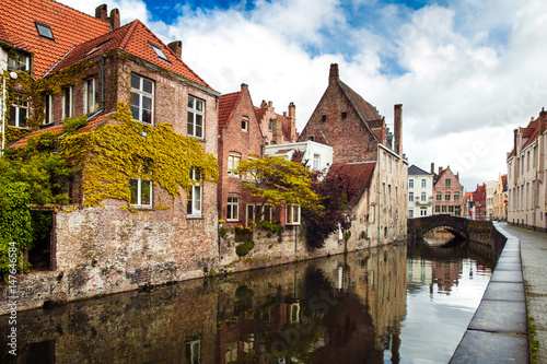 Deurstickers Brugge Architecture of Bruges city, traditional houses view on the canal