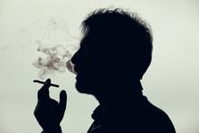 Man Smoking A Cigarette. Silhouette