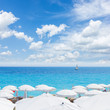 turquiose water of cote dAzur over white beach umbrellas, Nice France