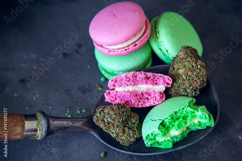 Eating Marijuana Edibles On Vintage Spoon With Cannabis Nugs On Dark Slate Background. Selective Focus With Copy Space.