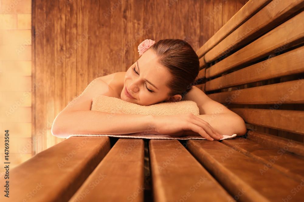 Fototapeta Beautiful young woman in sauna