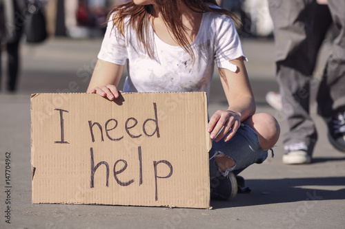 Poor woman begging for help on the street Canvas Print