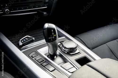 Fototapeta automatic gear stick of a modern car, car interior details obraz