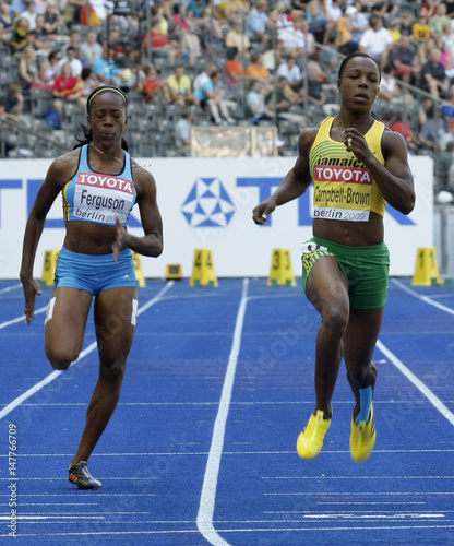 Campbell-Brown of Jamaica and Ferguson of Bahamas cross the