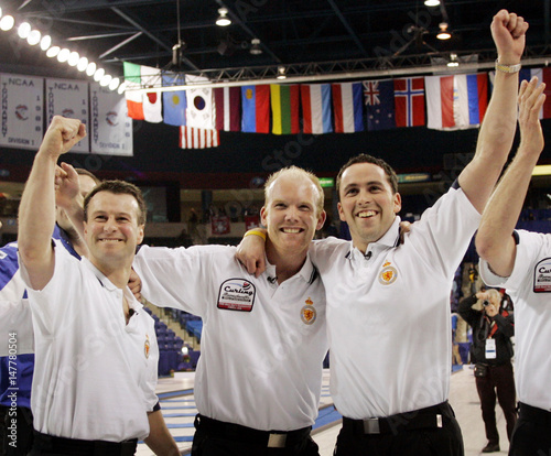 Scotlands Smith MacDonald And Skip Murdoch Celebrate After Beating Canada 7 4 To Win 2006 World Mens Curling Championship In Lowell