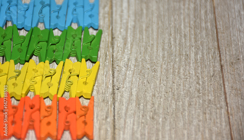 Colorful Clothespins On A Wooden Background Great For Crafts