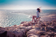 Girl on the top of Cape Greco in Cypruss