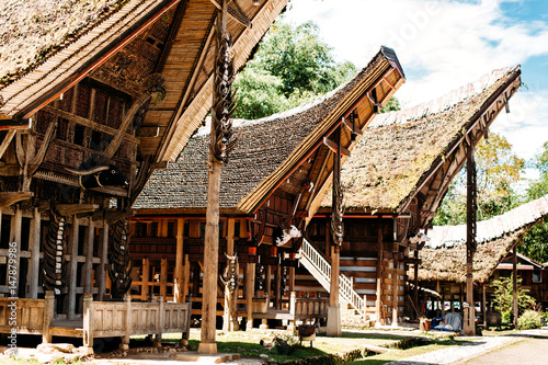 Foto op Plexiglas Indonesië Tongkonan houses with horns of buffaloes and wood carving and paintings, traditional torajan buildings. Ethnic village Kete Kesu in Tana Toraja, Rantepao, Sulawesi, Indonesia. Wide angle
