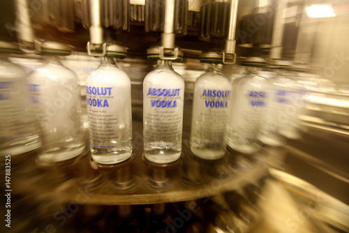 Empty bottles are washed on a production line at the Absolut
