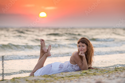 On The Beach At Sunset In White Dress