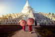 Leinwanddruck Bild - Novices under umbrellas at historic temple, Mingun, Mandalay, Myanmar
