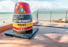 KEY WEST, FL - FEBRUARY 21, 2016: Southernmost Point Post Along The Ocean. This Is A Famous Attraction In Key West