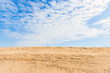 Blue sky and yellow sand
