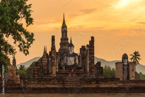 Fototapeta  Ancient pagoda and big buddha at Sukhothai Historical Park.