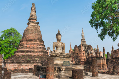 Fotografie, Obraz  Ancient pagoda and big buddha at Sukhothai Historical Park.
