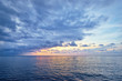 Beautiful seascape with sunset cloudy sky.