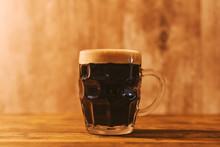 Dark Craft Beer In British Dimpled Glass Pint Mug
