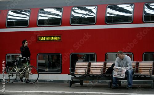 Deutsche Bahn regional train stands inside the departure