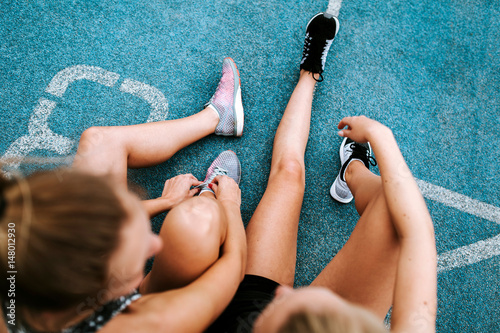 girls sitting on sports ground